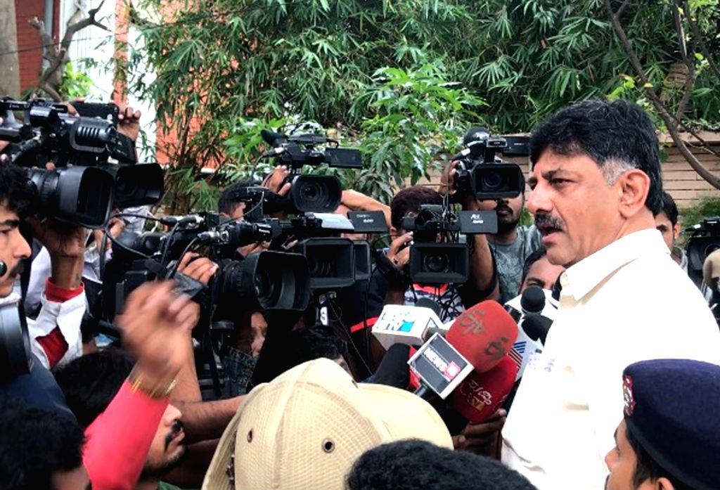 Karnataka Energy Minister DK Shivakumar talks to press at his residence after Income tax department raids in Bengaluru on Aug 5, 2017. - D