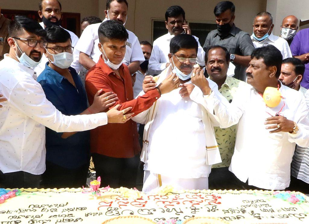 Karnataka Food and Civil Supply Minister K. Gopalaiah celebrates his 60th birthday, in Bengaluru on June 23, 2020. - K. Gopalaiah