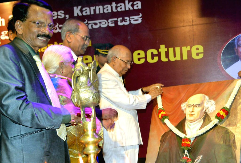 Karnataka Governor H R Bhardwaj with Homeopathic Dr B T Rudresh during an Endowment Lecture organised on World Homeopathy Day at RGUHS in Bangalore on April 30, 2014. - H R Bhardwaj