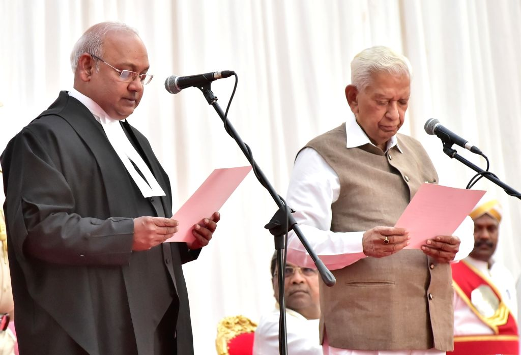 Karnataka Governor Vajubbhai Vala administers the oath of office to Justice Dinesh Maheshwari as he is sworn in as the Chief Justice of Karnataka High Court in Bengaluru on Feb 12, 2018.