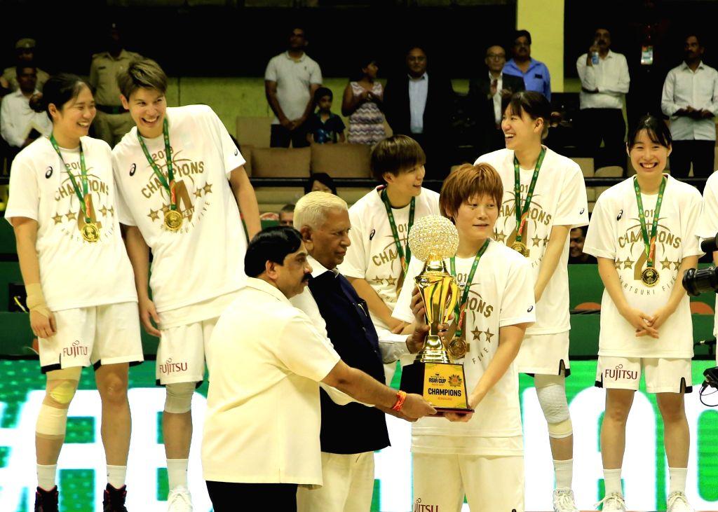 Karnataka Governor Vajubhai R Vala presents the 2019 FIBA Women's Asia Cup trophy to Japan after they beat China at Sree Kanteerava Stadium, in Bengaluru on Sep 29, 2019.