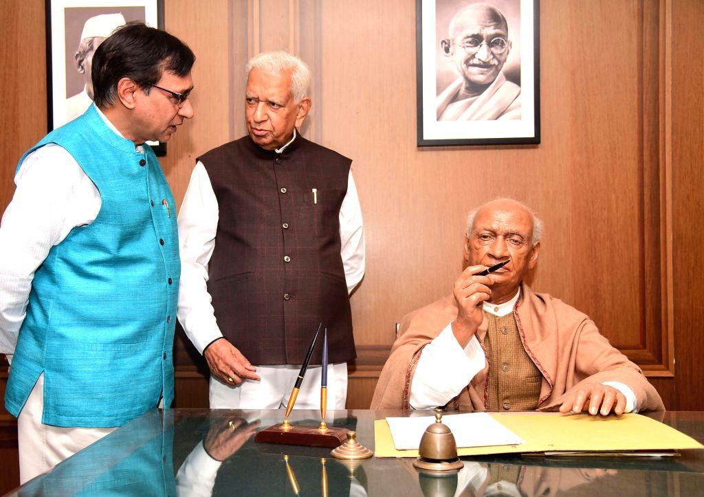 Karnataka Governor Vajubhai Rudabhai Vala and Visvesvaraya Industrial and Technological Museum Director KG Kumar with the wax statue of Sardar Patel kept on display during the inauguration ... - Sardar Patel