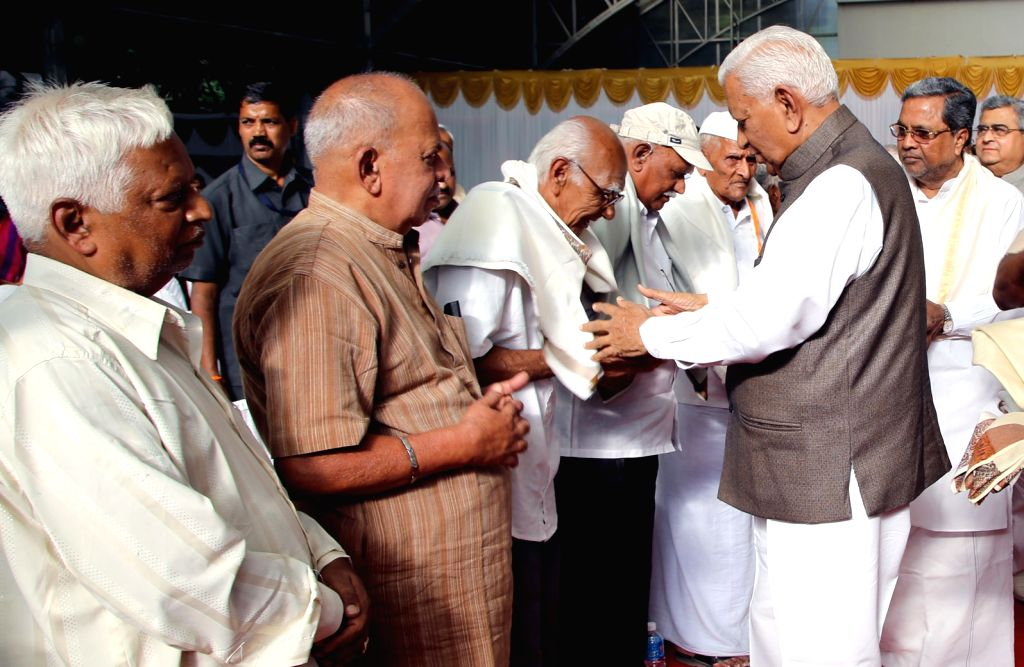 Karnataka Governor Vajubhai Rudabhai Vala greets freedom fighters during the tea party organised at Rajbhavan in Bengaluru on Aug 9, 2016.