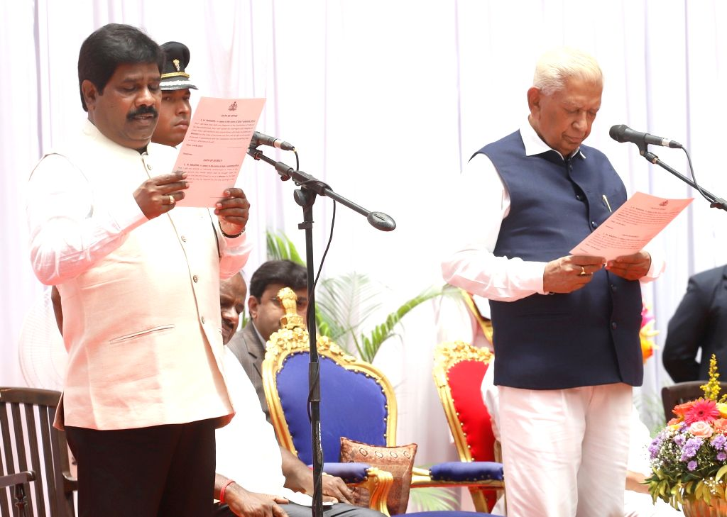 Karnataka Governor Vajubhai Vala administers the oath of office to Independent MLA H. Nagesh as cabinet minister in the year-old Janata Dal-Secular (JD-S)-Congress coalition government in ...