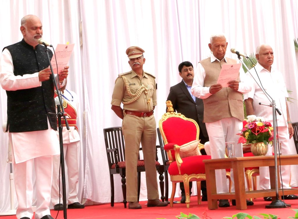Karnataka Governor Vajubhai Vala administers the oath of office to Shivaram Hebbar as the new Cabinet Minister at a swearing-in ceremony held at Raj Bhavan, in Bengaluru on Feb 6, 2020. ...