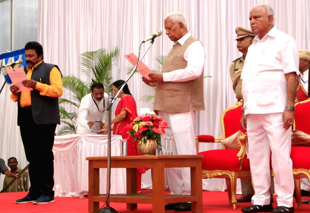 Karnataka Governor Vajubhai Vala administers the oath of office to BC Patil as the new Cabinet Minister at a swearing-in ceremony held at Raj Bhavan, in Bengaluru on Feb 6, 2020. Vala on ...