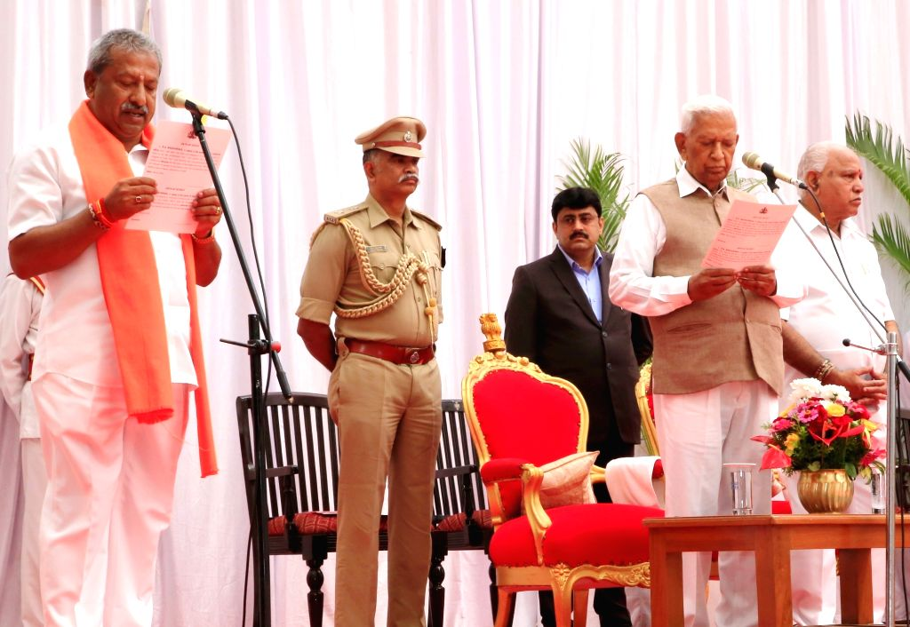 Karnataka Governor Vajubhai Vala administers the oath of office to B A Basavaraju as the new Cabinet Minister at a swearing-in ceremony held at Raj Bhavan, in Bengaluru on Feb 6, 2020. ...