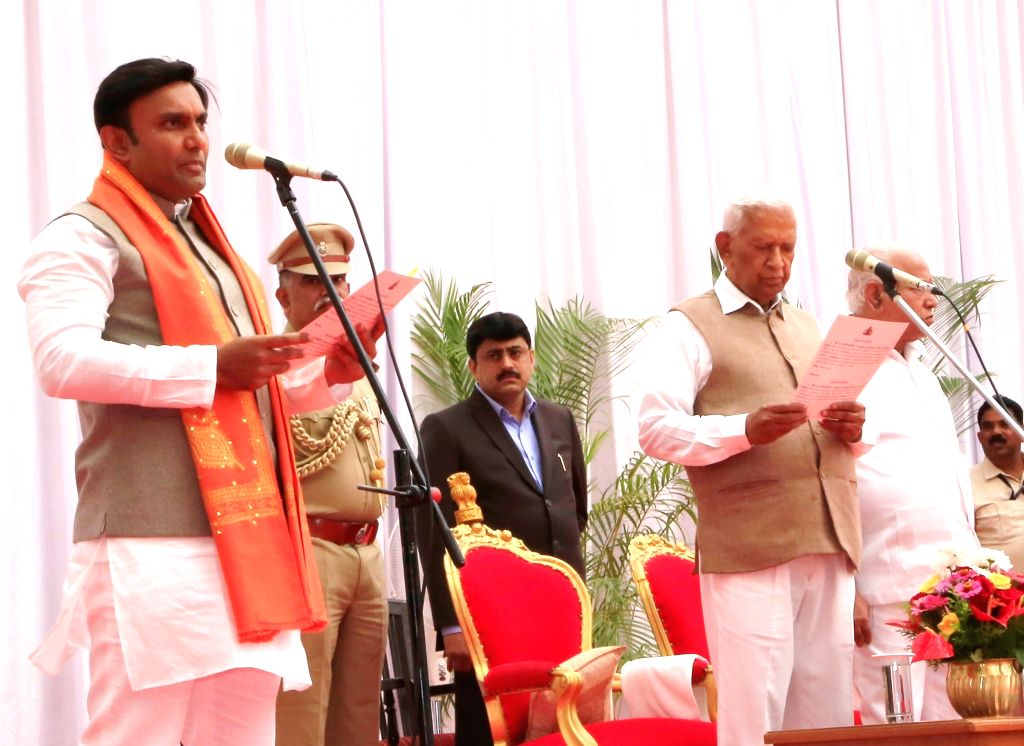 Karnataka Governor Vajubhai Vala administers the oath of office to K Sudhakar as the new Cabinet Minister at a swearing-in ceremony held at Raj Bhavan, in Bengaluru on Feb 6, 2020. Vala on ...