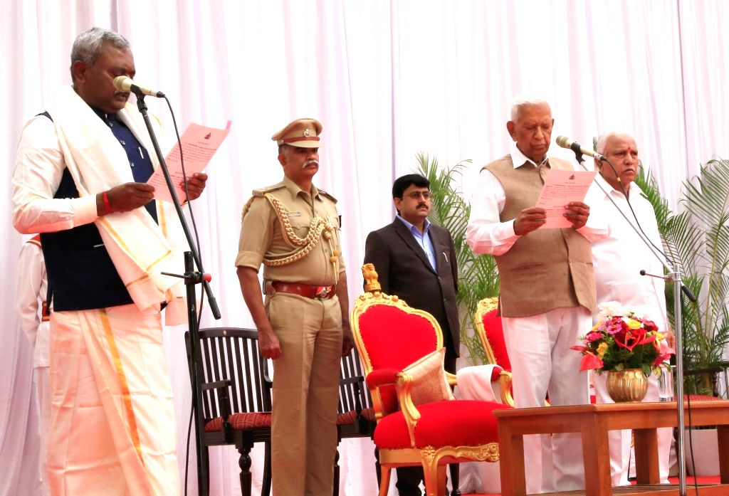 Karnataka Governor Vajubhai Vala administers the oath of office to S T Somashekar as the new Cabinet Minister at a swearing-in ceremony held at Raj Bhavan, in Bengaluru on Feb 6, 2020. ...