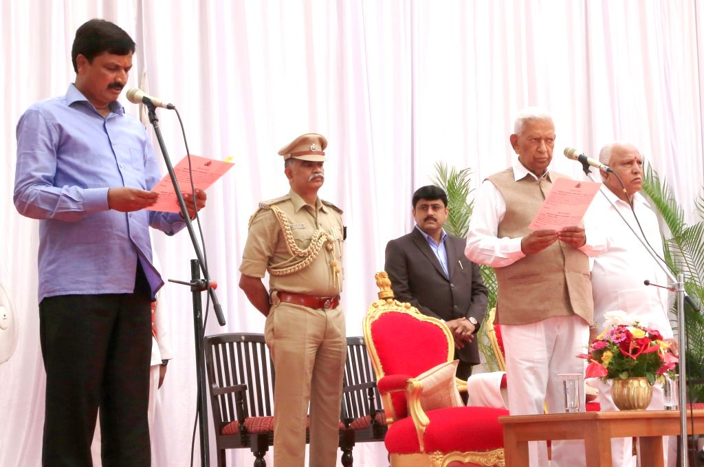 Karnataka Governor Vajubhai Vala administers the oath of office to Ramesh Jarakiholi as the new Cabinet Minister at a swearing-in ceremony held at Raj Bhavan, in Bengaluru on Feb 6, 2020. ...