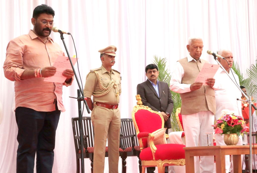 Karnataka Governor Vajubhai Vala administers the oath of office to Anand Singh as the new Cabinet Minister at a swearing-in ceremony held at Raj Bhavan, in Bengaluru on Feb 6, 2020. Vala ... - Anand Singh