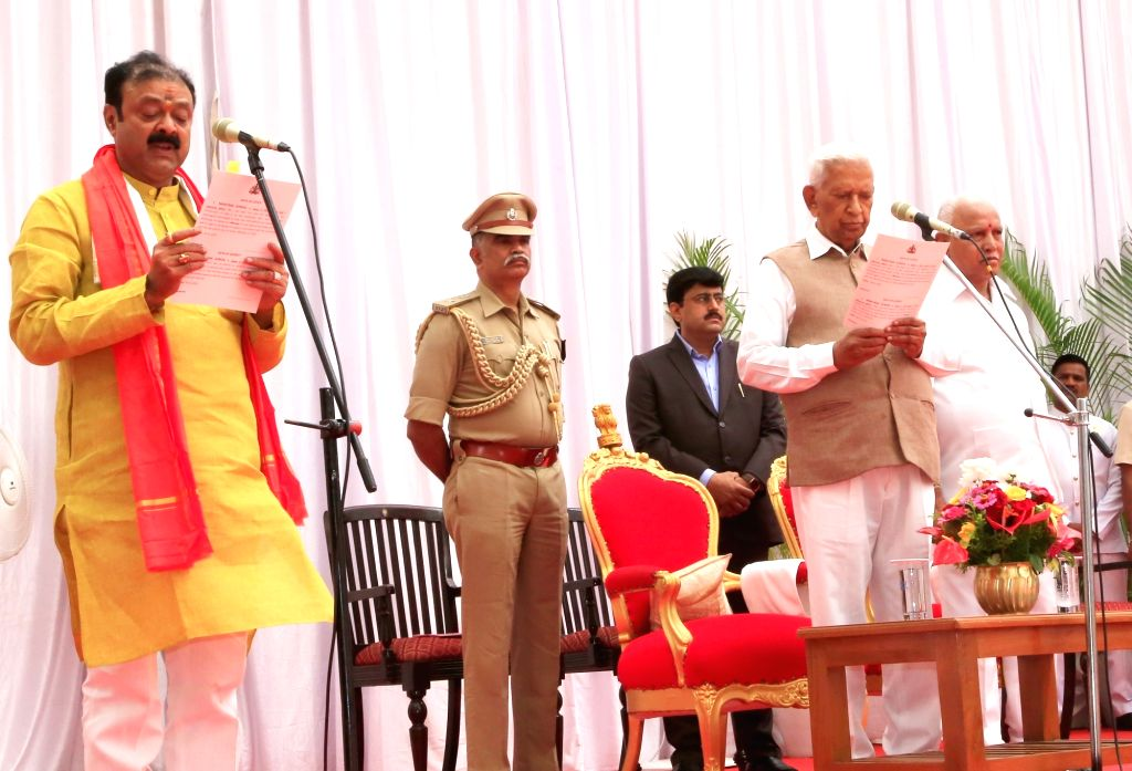 Karnataka Governor Vajubhai Vala administers the oath of office to Narayana Gowda as the new Cabinet Minister at a swearing-in ceremony held at Raj Bhavan, in Bengaluru on Feb 6, 2020. ...