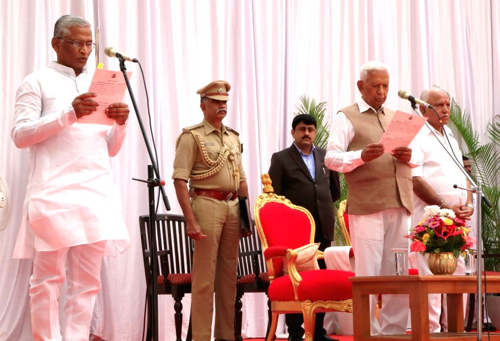Karnataka Governor Vajubhai Vala administers the oath of office to Shrimant Patil as the new Cabinet Minister at a swearing-in ceremony held at Raj Bhavan, in Bengaluru on Feb 6, 2020. ... - Shrimant Patil