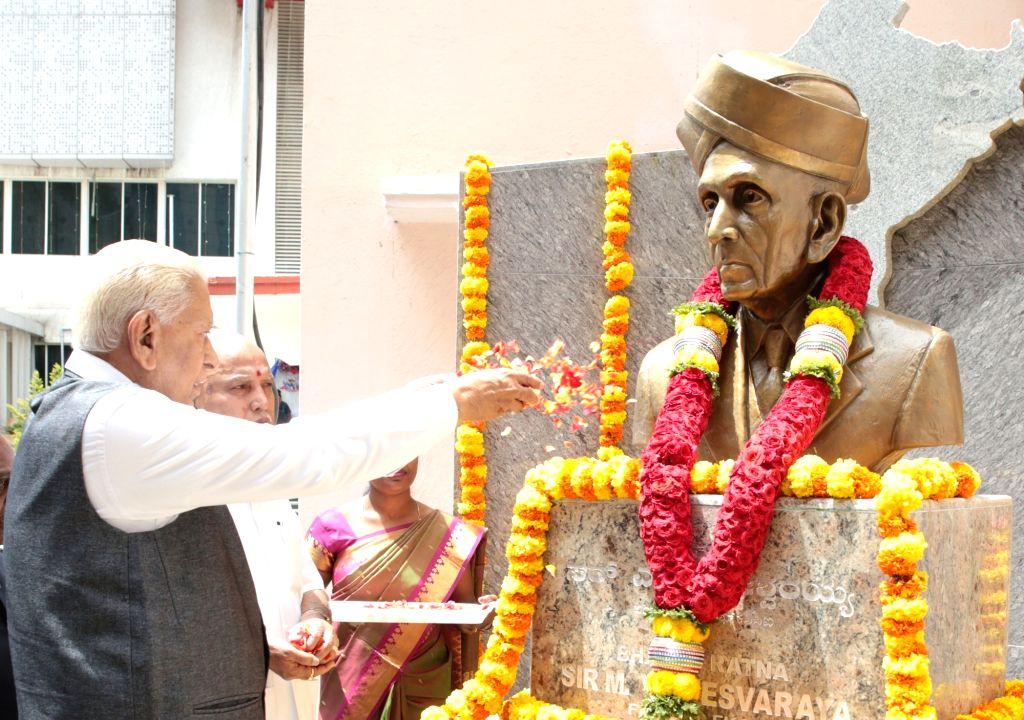 Karnataka Governor Vajubhai Vala and Chief Minister BS Yediyurappa pay tribute to Sir MV Visvesvaraya to mark his birth anniversary, during Founders Day of Federation of Karnataka Chambers ... - B