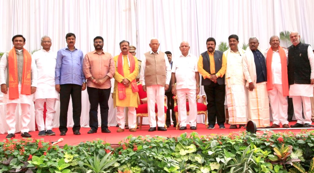 Karnataka Governor Vajubhai Vala and Chief Minister B.S. Yediyurappa with the newly inducted Cabinet Ministers at a swearing-in ceremony held at Raj Bhavan, in Bengaluru on Feb 6, 2020. ... - B.