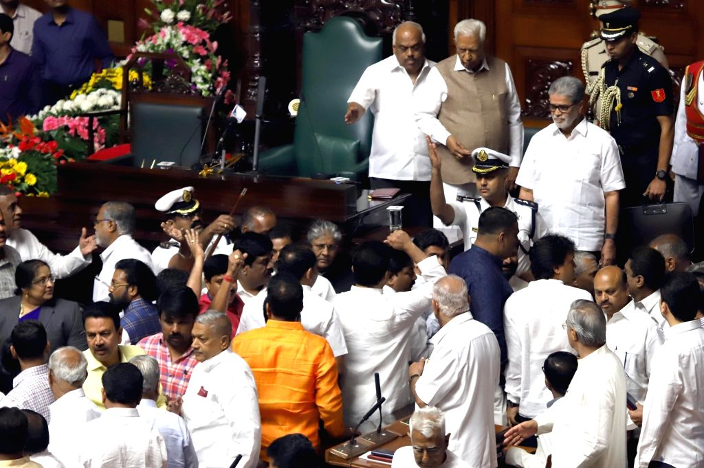 Karnataka Governor Vajubhai Vala and state assembly Speaker K. R. Ramesh Kumar look on as BJP MLAs create ruckus during the state assembly's Budget Session, in Bengaluru on Feb 6, 2019. - K. R. Ramesh Kumar