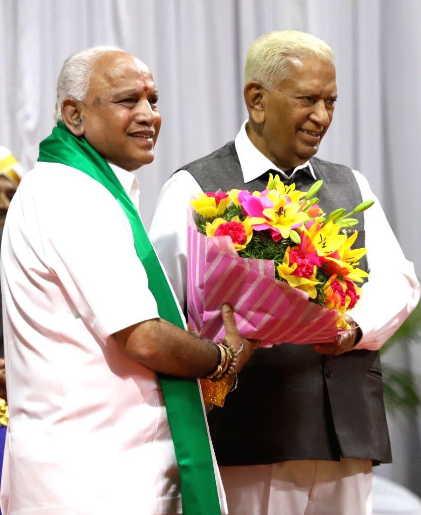 Karnataka Governor Vajubhai Vala greets the newly sworn-in Chief Minister B. S. Yediyurappa after the latter took oath of office at a swearing-in ceremony at Raj Bhavan in Bengaluru non ... - B. S. Yediyurappa