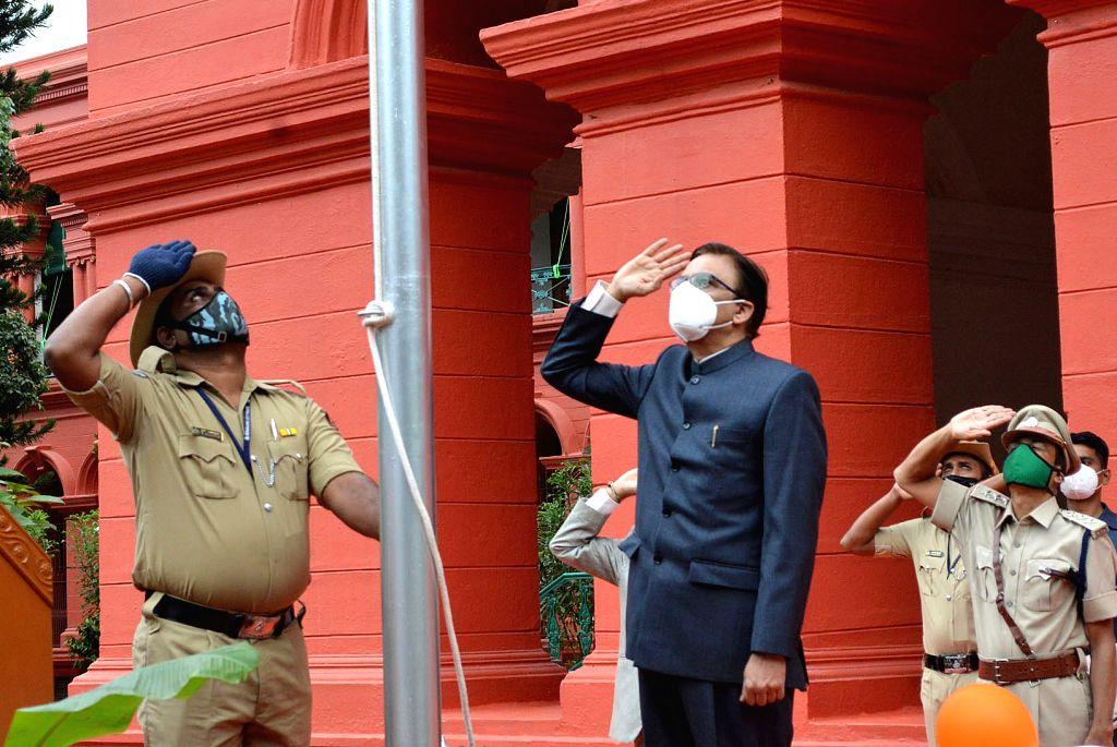 Karnataka High Court Chief Justice Abhay Shreeniwas Oka unfurls the tricolor during 74th Independence Day celebrations at the Karnataka High Court in Bengaluru on Aug 15, 2020.