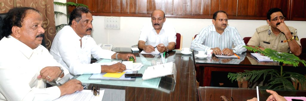 Karnataka Home Minister KJ George and state minister Roshan Baig at a meeting with Bangalore City Police Commissioner Ragavendra Auradkar, state Haj Committee president and senior officials regarding - K