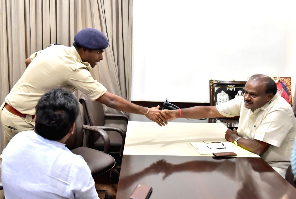 Karnataka Indian Police Service (IPS) officer K. Annamalai, who resigned from the high-profile job as Bengaluru South Division Deputy Commissioner of Police meets Karnataka Chief Minister ... - H D Kumaraswamy