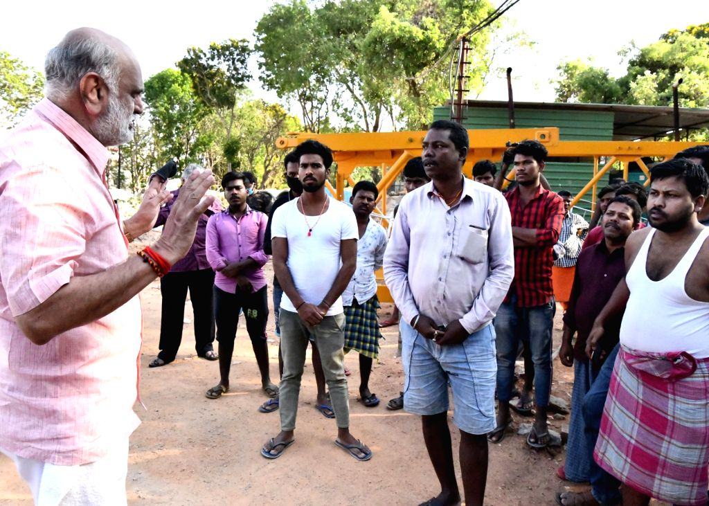 Karnataka Labour Minister Shivram Hebbar interacts with migrant labours from northern states at their construction sites in Bengaluru. - Shivram Hebbar