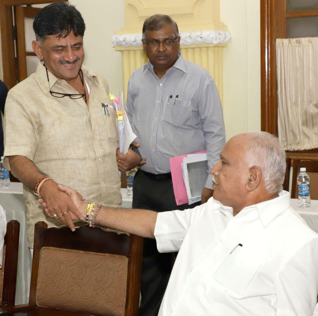Karnataka Major Irrigation and Medical Education Minister D. K. Shivakumar and state BJP chief B.S. Yeddyurappa during an all-party-meeting called by Karnataka Chief Minister H.D. ... - D. K. Shivakumar