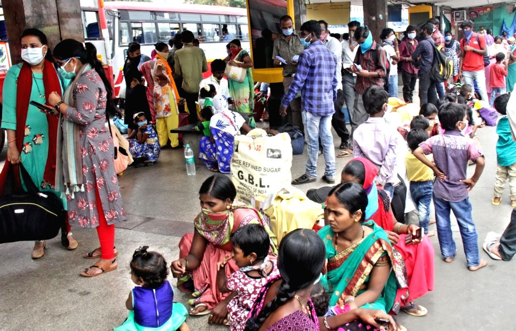 Karnataka migrant workers who were stranded in different parts of the country arrive at the Majestic Bus station in Bengaluru from were they will proceed to their prospective native ...