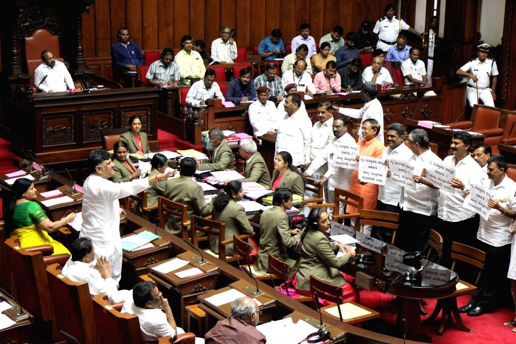 Karnataka Minister D. K. Shivakumar argues with BJP MLCs protesting during the Karnataka Legislative Council Session at the state assembly, in Bengaluru on July 16, 2019. - D. K. Shivakumar