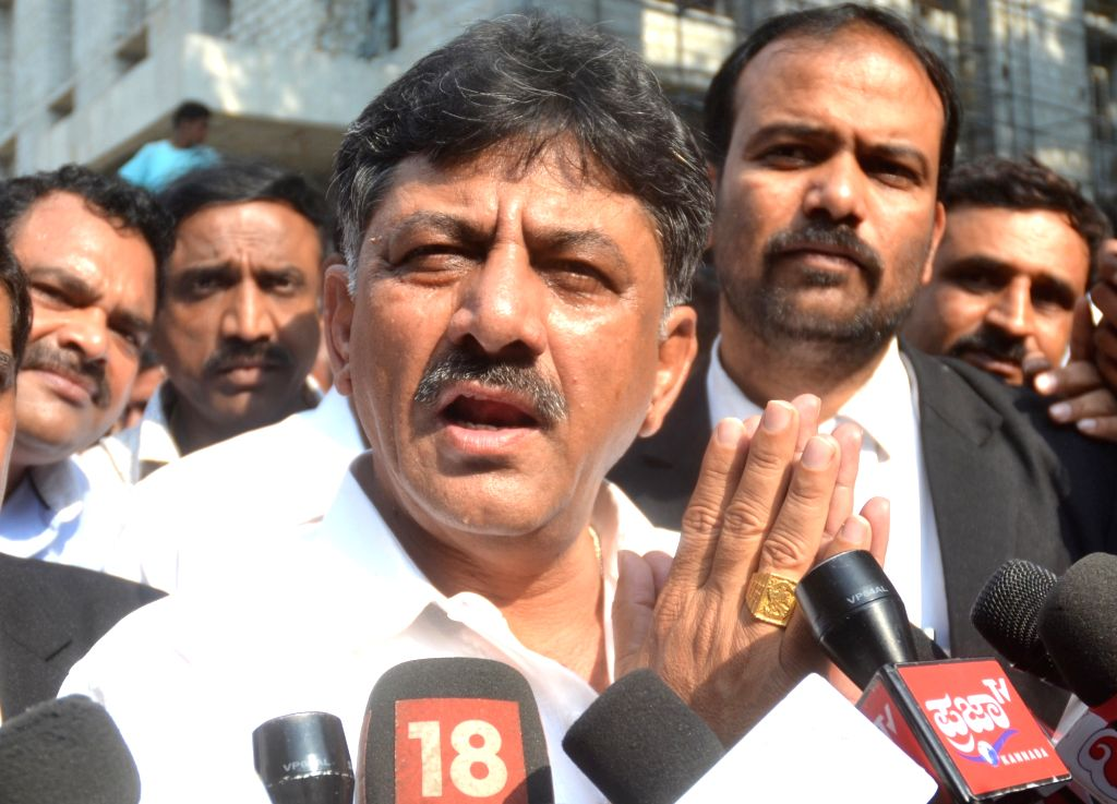 Karnataka Minister D. K. Shivakumar talks to press after coming out of the Economic Offences Court in Bengaluru on March 22, 2018. - D. K. Shivakumar