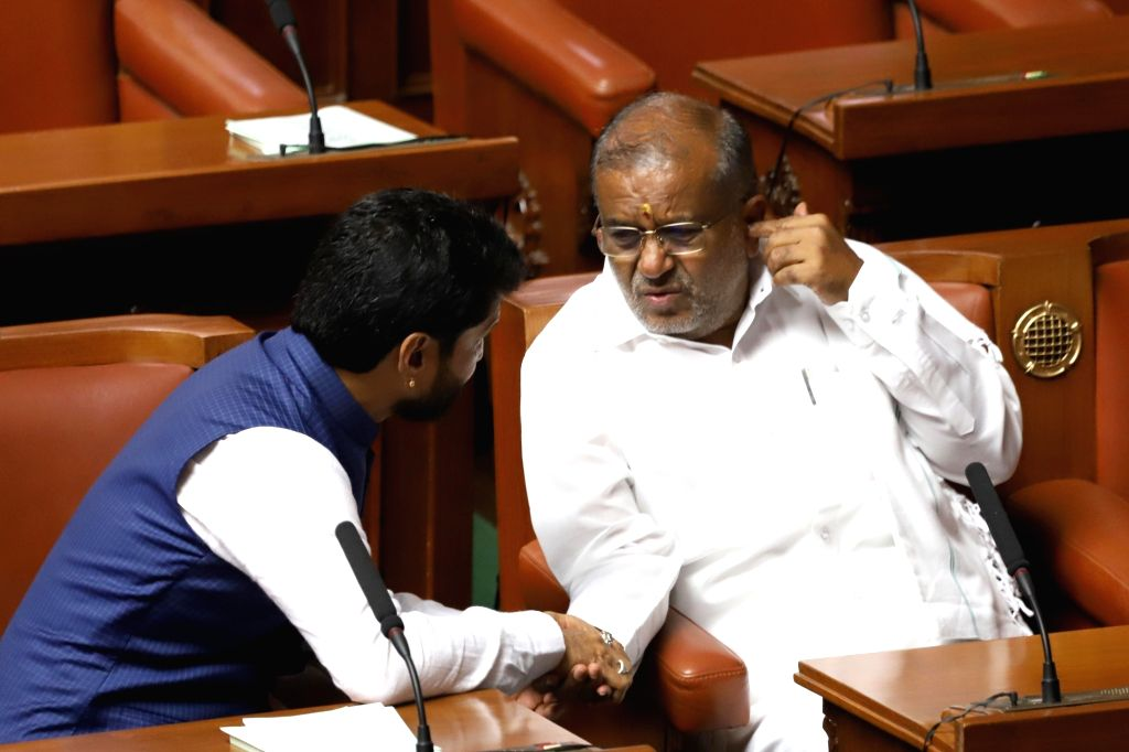 Karnataka Minister GT Devegowda and BJP leader C T Ravi in the state assembly where Chief Minister HD Kumaraswamy moved motion of confidence in Bengaluru on July 18, 2019. - G