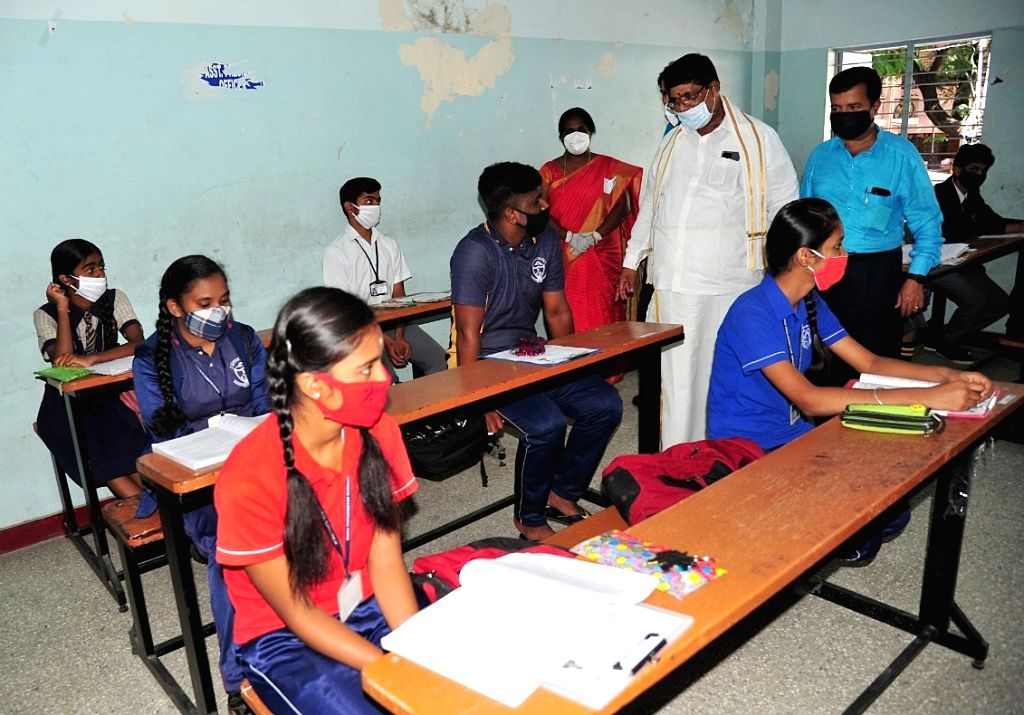 Karnataka Minister K. Gopalaiah interacts with students appearing for their remaining Secondary School Leaving Certificate (SSLC) examinations, during his visit to Mahalakshmi Layout to ... - K. Gopalaiah
