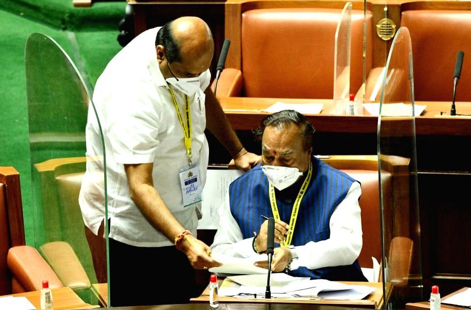Karnataka Minister KS Eshwarappa in a conversation with JD-S MLA Bandeppa Kashempur during the Monsoon Session of the State Assembly, at Vidhana Soudha in Bengaluru on Sep 23, 2020. - K