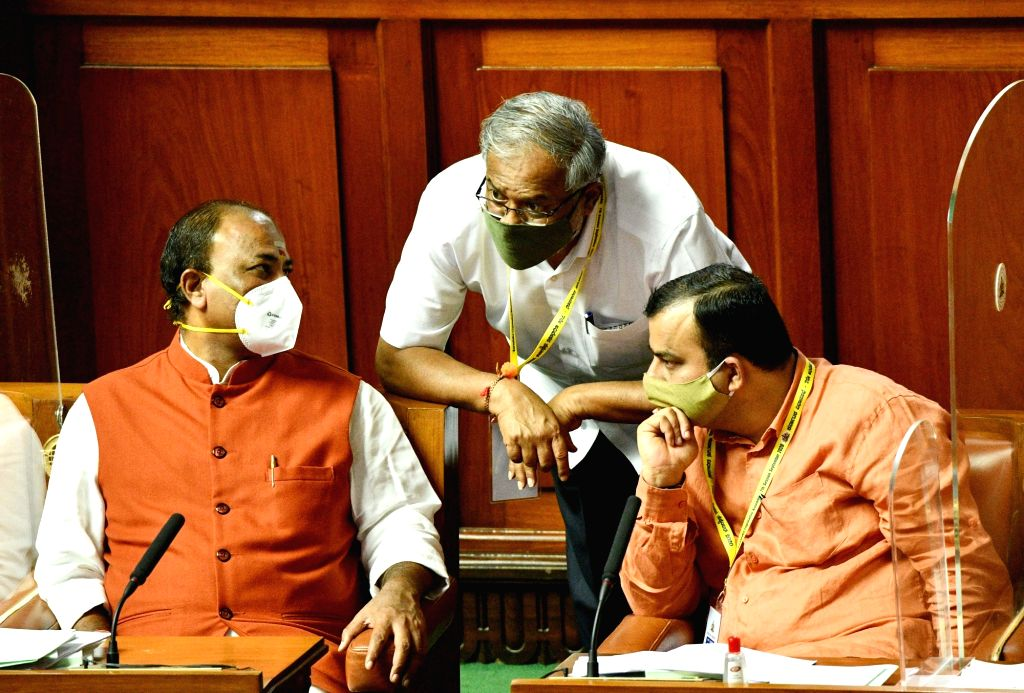 Karnataka Minister Sureshkumar in a conversation with BJP MLAs during the Monsoon Session of the State Assembly, at Vidhana Soudha in Bengaluru on Sep 23, 2020. - Sureshkumar