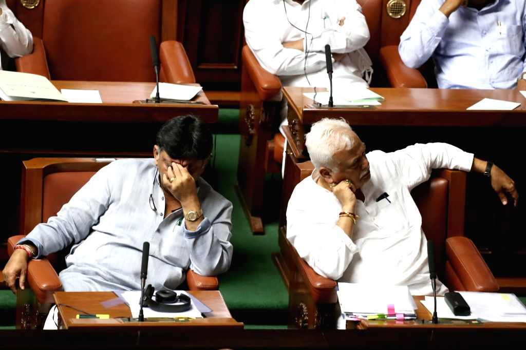Karnataka Ministers D.K. Shivakumar and R.V. Deshpande during the state assembly Monsoon Session, in Bengaluru on July 15, 2019. (Photo: IANS) - D.