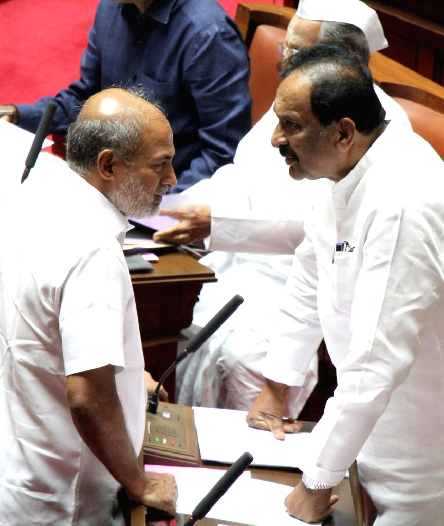Karnataka Ministers K. J. George and Sa Ra Mahesh during the Karnataka Legislative Council Session at the state assembly, in Bengaluru on July 16, 2019. - K. J. George and S