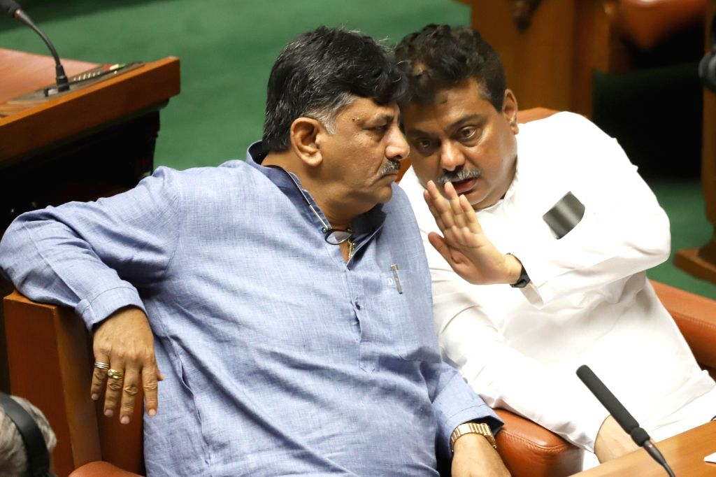 Karnataka Ministers MB Patil and DK Shivakumar in state assembly where Chief Minister HD Kumaraswamy moved motion of confidence in Bengaluru on July 18, 2019. - H and M