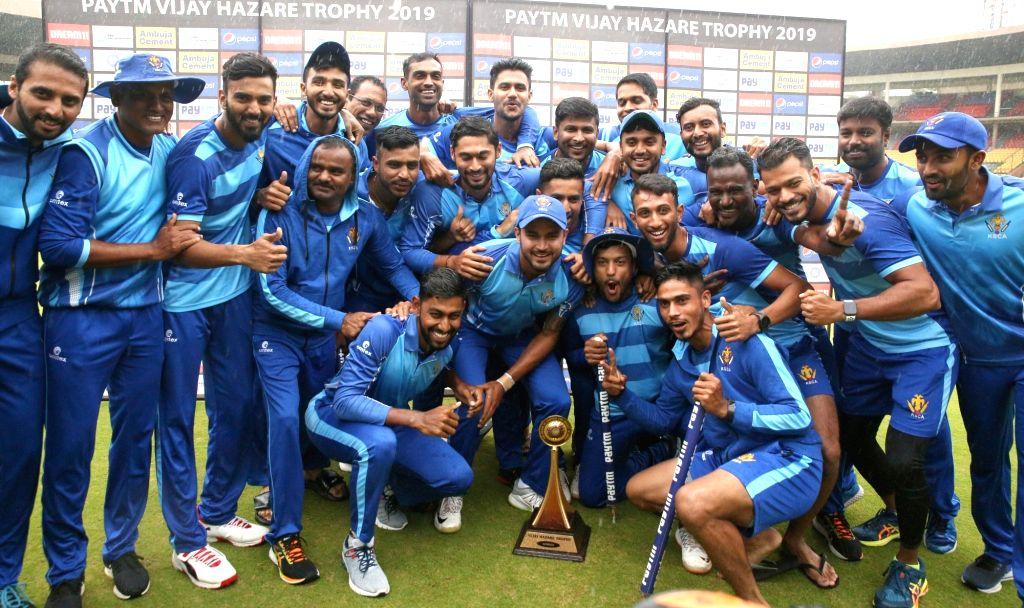 Karnataka players celebrate after winning the Vijay Hazare Trophy against Tamil Nadu at M Chinnaswamy Stadium, in Bengaluru on Oct 25, 2019. Karnataka won by 60 runs.