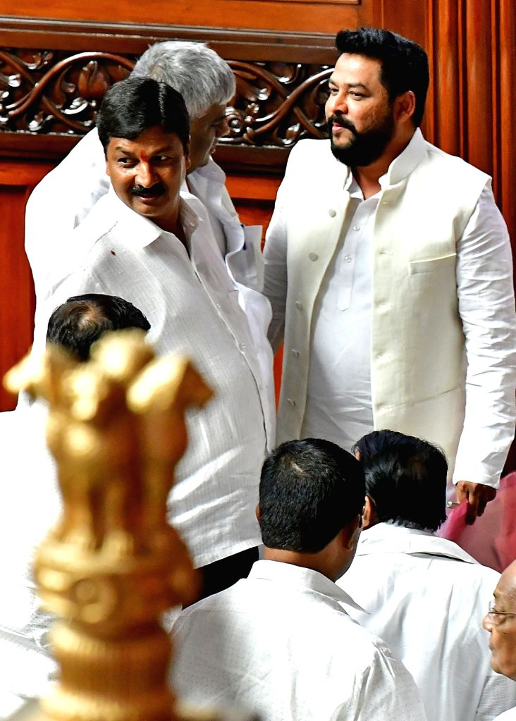 Karnataka PWD Minister H.D. Revanna with Congress leaders B Nagendra and Ramesh Jarkiholi during budget session of state assembly in Bengaluru, on Feb 14, 2019. - H.