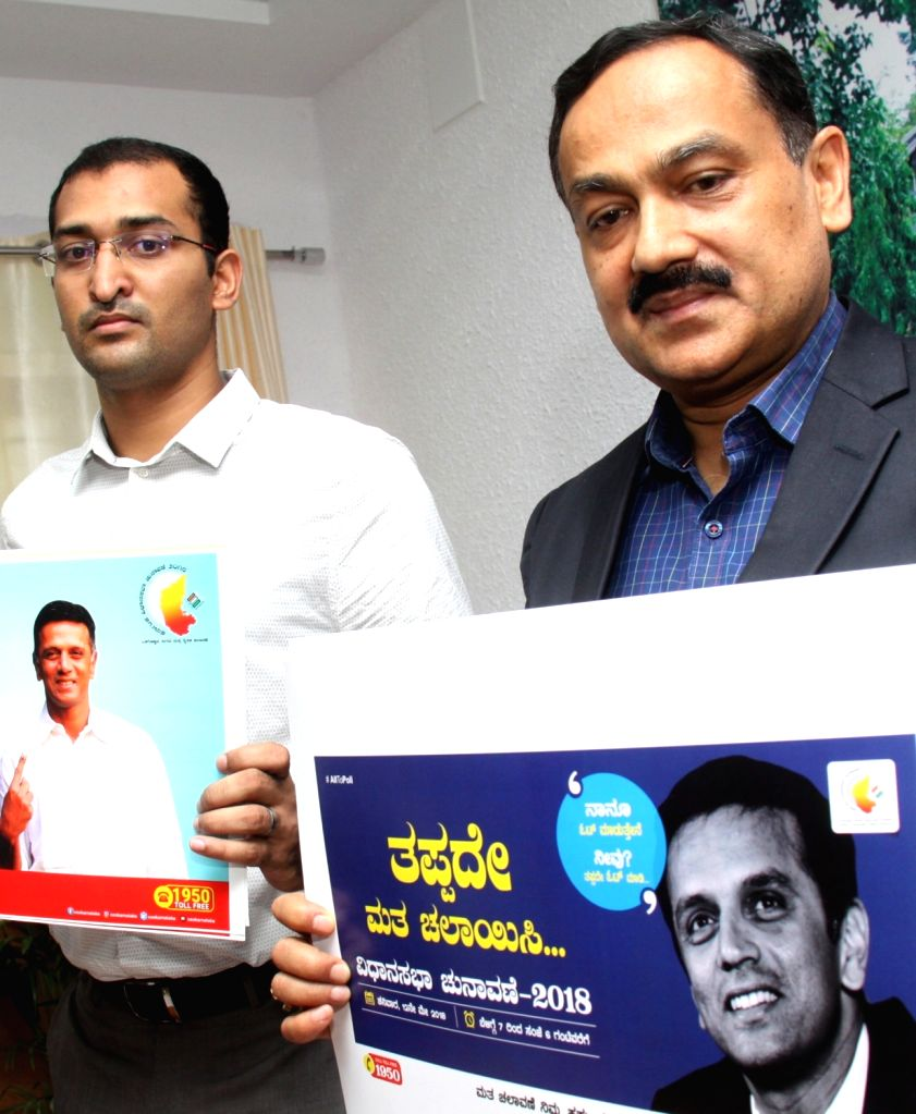 Karnataka's Chief Electoral Officer (CEO) Sanjiv Kumar launches election posters with former cricketer Rahul Dravid's photo, who has been appointed as the state election icon, ahead of the ... - Sanjiv Kumar