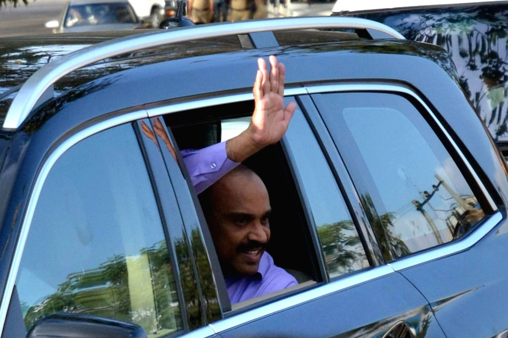 Karnataka's former BJP minister and mining baron G. Janardhana Reddy, waves at his supporters after the Supreme Court granted him conditional bail in graft cases related to the multi-crore mining ... - G. Janardhana Reddy