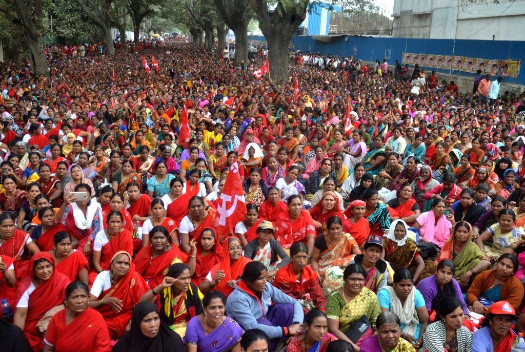 Karnataka State Akshara Dasoha Employees Association members participate in protest rally demanding for hike in salaries from Bengaluru City Railway Station to Freedom Park, in Bengaluru ...