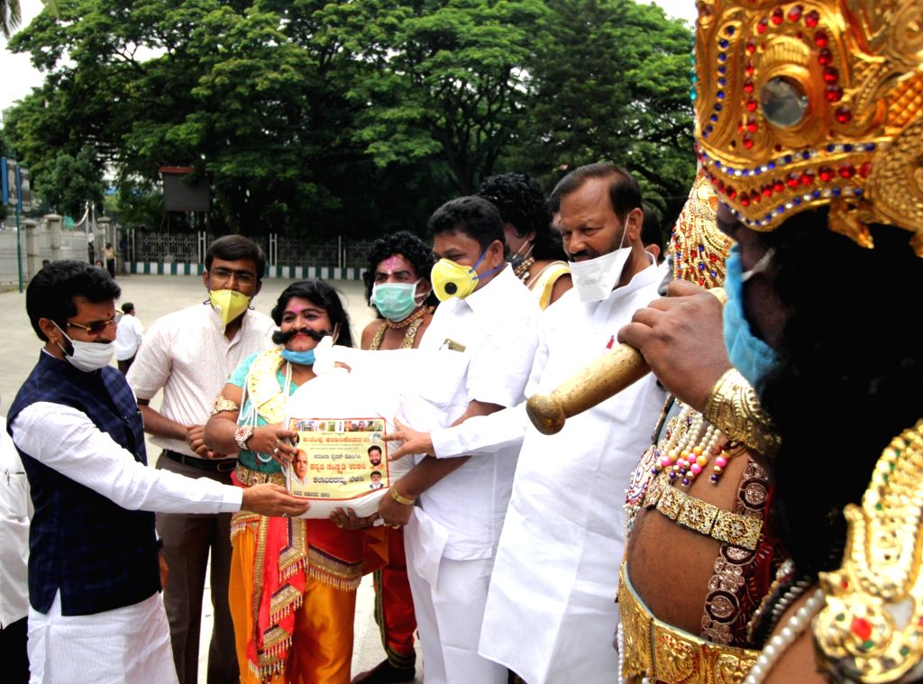 Karnataka Tourism, Kannada and Culture Minister C.T. Ravi distributes ration kits among artistes in Bengaluru during the extended nationwide lockdown imposed to mitigate the spread of ... - C.