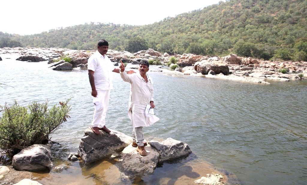 Karnataka Water Resources Minister D. K. Shivakumar on the banks of Cauvery river during his visit to the site where the proposed Mekedatu dam would be constructed across the river, in Mysuru ... - D. K. Shivakumar