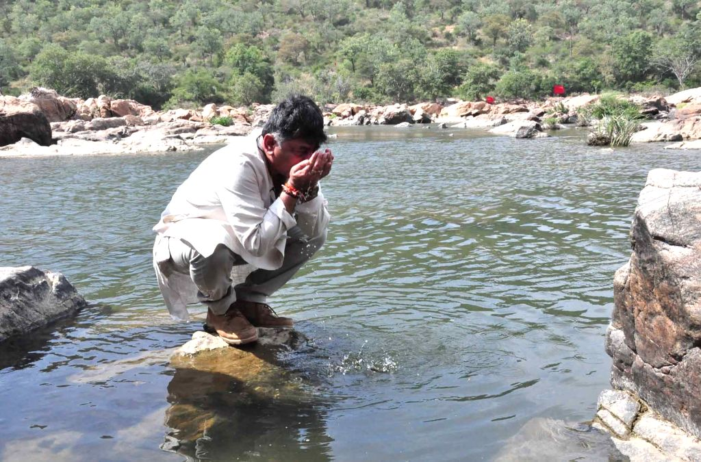 Karnataka Water Resources Minister D. K. Shivakumar drinks the water of Cauvery river during his visit to the site where the proposed Mekedatu dam would be constructed across the river, in ... - D. K. Shivakumar