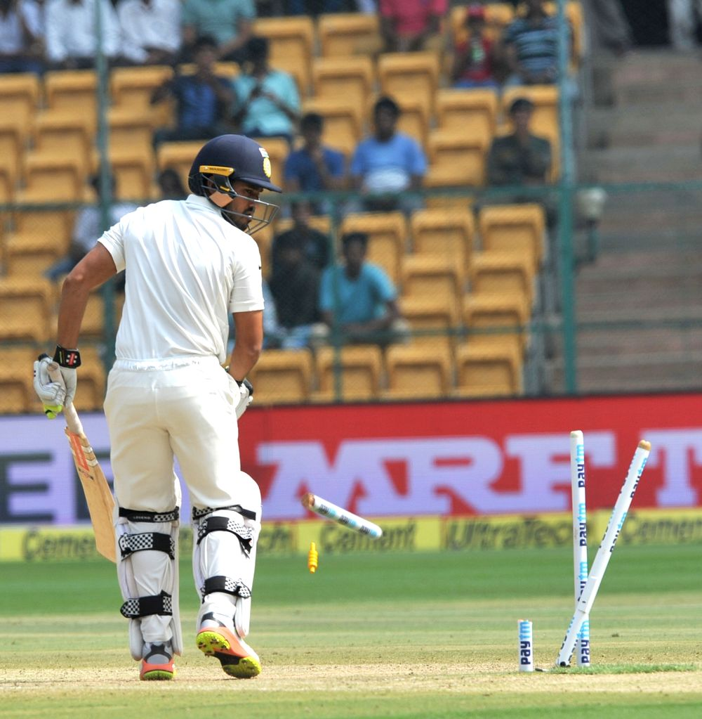Karun Nair of India gets dismissed during the fourth day of the second test match between India and Australia at M. Chinnaswamy Stadium in Bengaluru on March 7, 2017. (Photo: IANS)