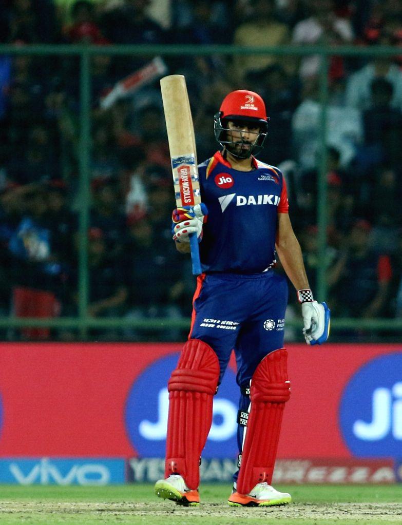 Karun Nair of the Delhi Daredevils raises his bat after reaching his fifty during match between the Delhi Daredevils and the Rising Pune Supergiant held at the Feroz Shah Kotla Stadium in ...