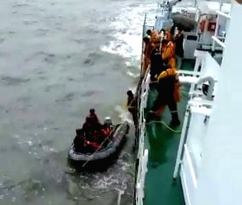 Karwar: Indian Coast Guards rescue fishermen from stranded fishing boat Rajkiran near Karwar, Karnataka on Oct 25, 2019. (Photo: IANS/ICG)