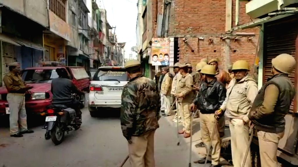 Kasganj: Police deployed after two groups clashed on Republic Day in Uttar Pradesh's Kasganj district on Jan 26, 2018. (Photo: IANS)