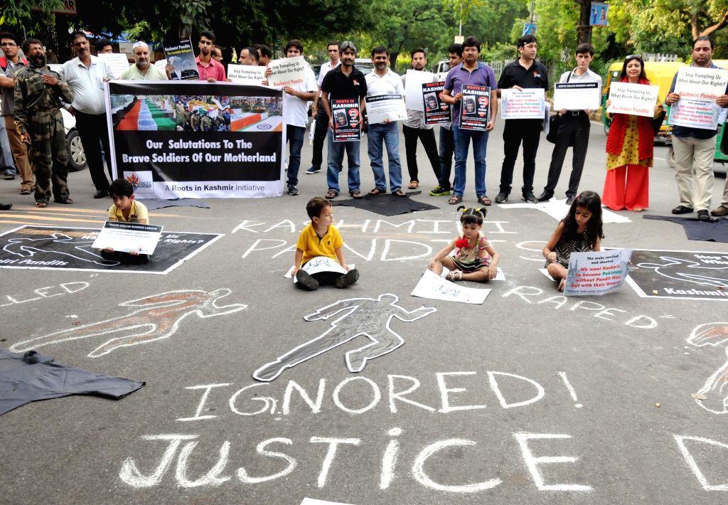 Kashmiri Pandits stage a demonstration against Hurriyat leaders for attacks on migrant people in Kashmir; at Jantar Mantar in New Delhi