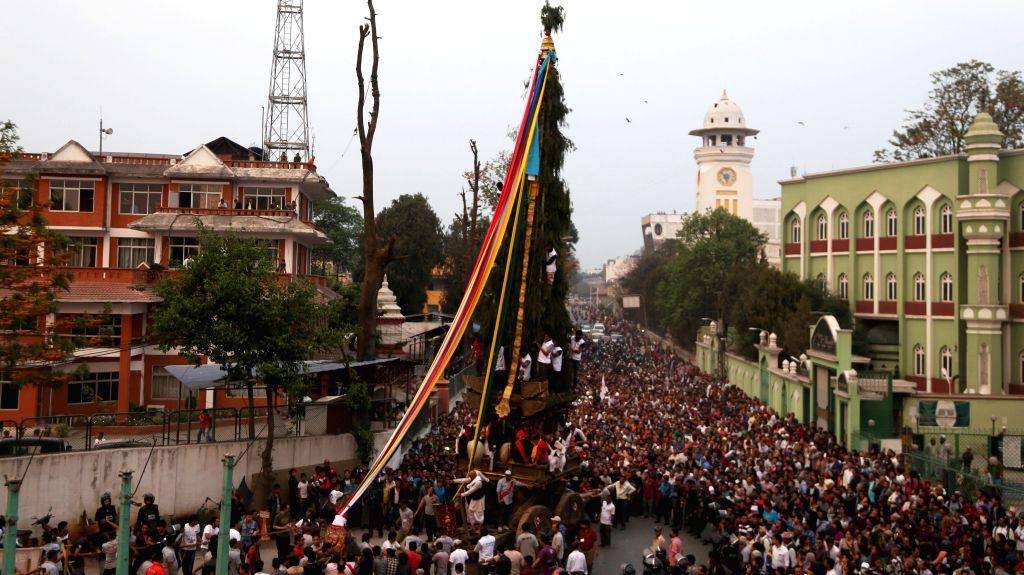 KATHMANDU, April 15, 2016 - Hindu devotees pull the chariot of Seto Machhendranath from Teendhara Pathsala towards Ason Tole to mark the beginning of Seto Machhendranath Chariot festival in ...